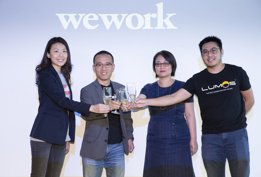 (From left to right) Kay Kam, Community Director, WeWork Hong Kong, Alan Ai, General Manager WeWork Greater China and WeWork members Vicky Wu, Founder of NBI Solutions, and Zhan Tang, Business Manager, Lumos Helmet, celebrate the launch of WeWork's first-ever location in Kowloon – Two Harbour Square.
