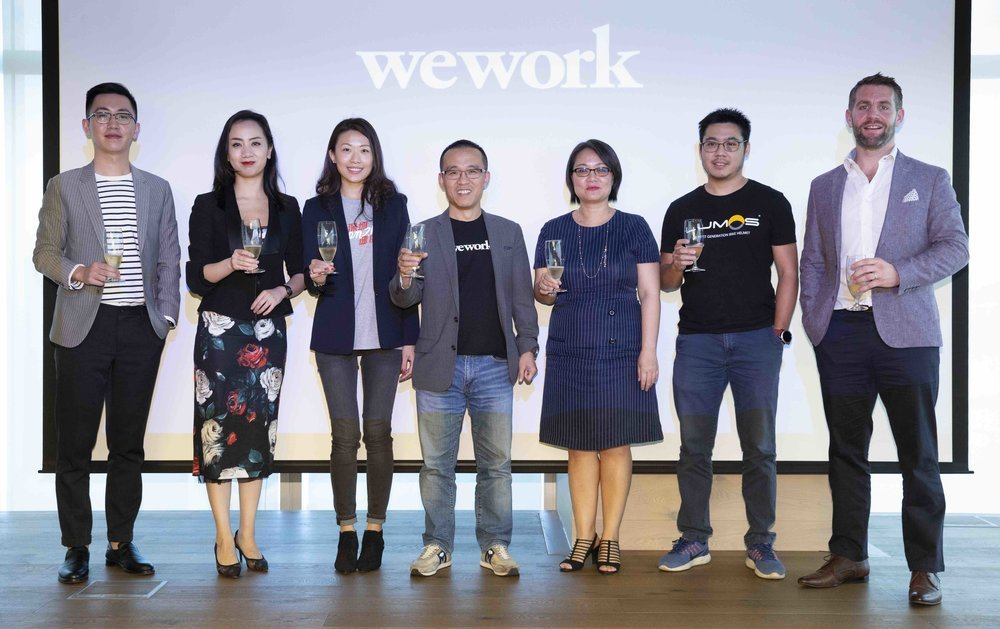 Guests and WeWork representatives and members celebrate the launch of WeWork's first-ever location in Kowloon – Two Harbour Square. From left to right, Toby Tan, Office Assets Management Dept. Supervisor, Officezip Manager, Angel Tang, Deputy General Manager, China Overseas Commercial Properties Co. Ltd, Kay Kam, Community Director, WeWork Hong Kong, Alan Ai, General Manager WeWork Greater China, WeWork members Vicky Wu, Founder of NBI Solutions and Zhan Tang, Business Manager, Lumos Helmet; and Mr. Michael Glancy, Director of Markets for JLL.